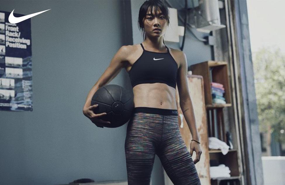 Nike | Woman holding medicine ball