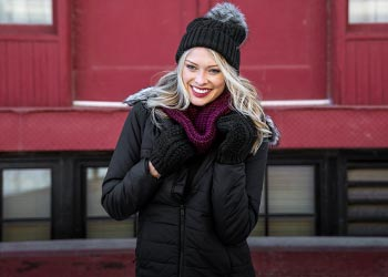 Woman wearing a beanie, scarf and gloves