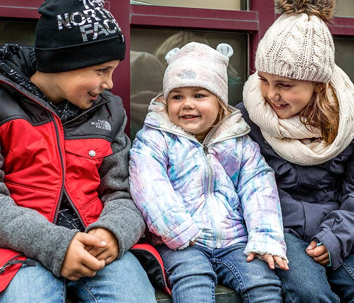 Children wearing cold weather apparel