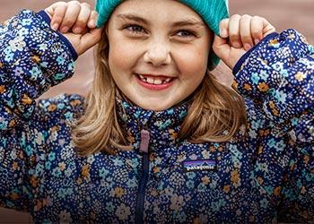 Girl wearing floral pattern Patagonia jacket