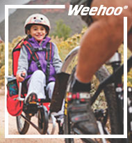 Image of Child riding Weehoo Trailer