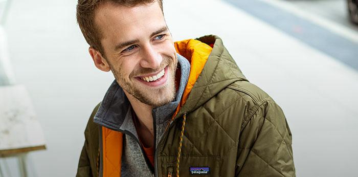 Man wearing a hooded jacket